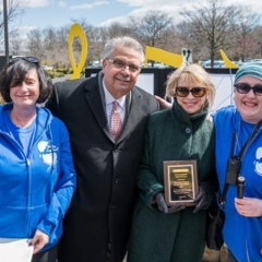 Lois and Richard Nicotra receive an award for their generous contributions and support.  ID: Mr. and Ms. Nicotra pose for a picture with Sophia Rossovsky and Holly Bonner.
