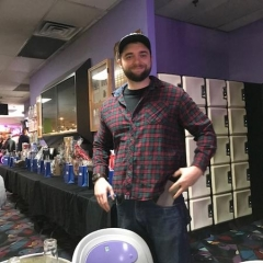 Bowl-A-Thon attendee.   ID: The attendee is smiling for the camera.