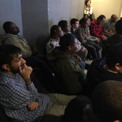 ID: A group of participants engrossed in the presentation.