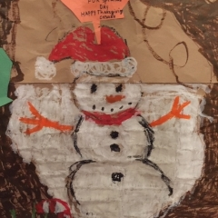 A snowman as part of a larger mural made by the participants.  ID: Snowman drawn at the center of the artwork.