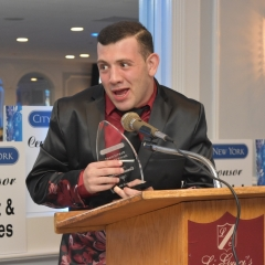 Carmine Mazza accepts an award