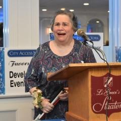 Ellen Rubin accepts an award.