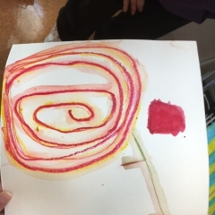 Drawing by a participant.  ID: Abstract art work in red and yellow.