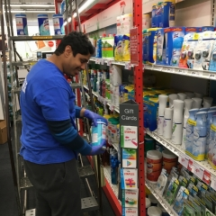 Participant restocking shelves at Staples, as part of City Access New York Vocation program.