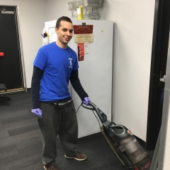 Participant vacuums while working at Staples.