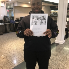 Participant holding up artwork celebrating Black History Month