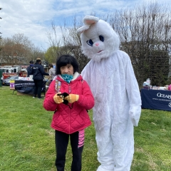 Participant posing with an Easter Bunny