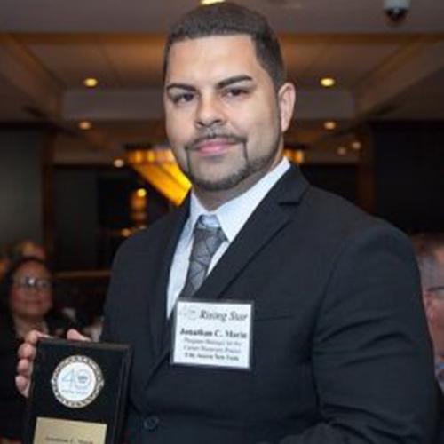 A Man holding an award