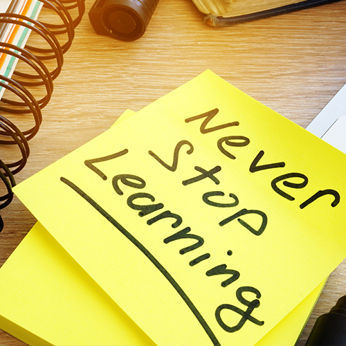 "a post-it that reads ""Never Stop Learning"""