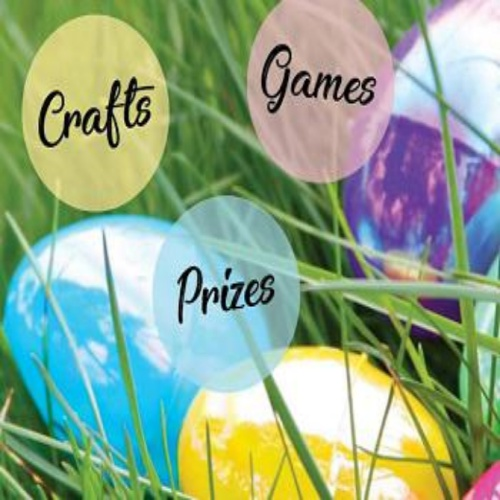 "Photo reads ""Crafts, Games, Prizes"" Eggs are in the grass"