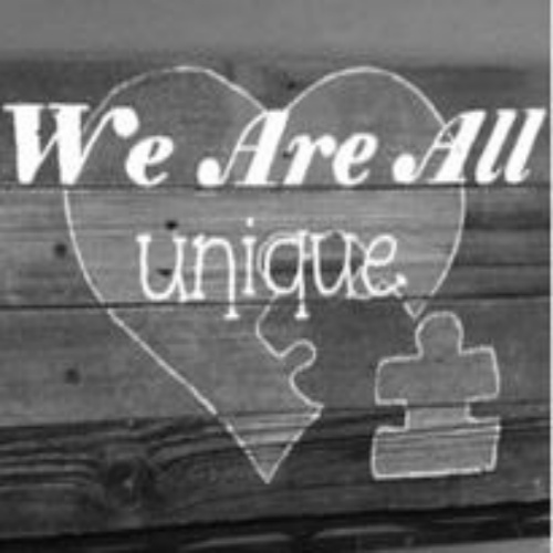 "Photo reads ""We Are All Unique"""