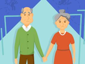An elderly couple holding hands.