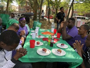 Participants sitting around a table in Dyker Park