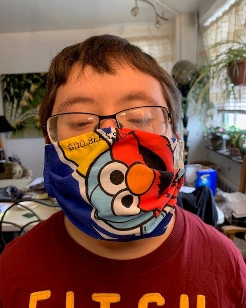 Participant wearing a colorful mask.